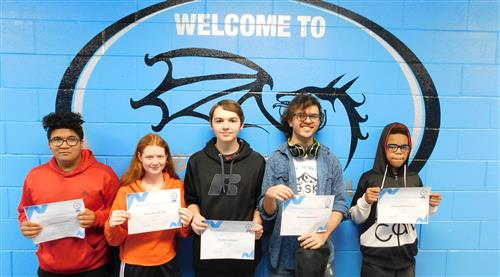 Five students holding perfect attendance awards in front of the BGS logo.